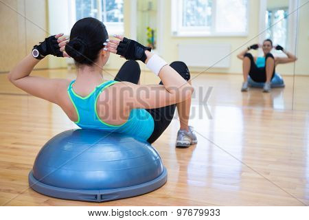Young Woman Doing Exercises On Bosu Ball
