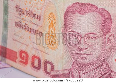 Close Up Of Thailand Currency, Thai Baht With The Images Of Thailand King. Denomination Of 100 Bahts