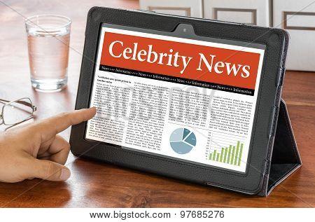 A Tablet Computer On A Desk - Celebrity News