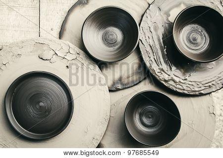 Dish raw ceramic (Do not burn)on wood background