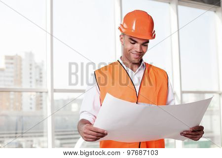Attractive young builder is working on new project