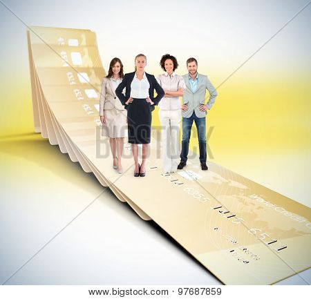 Business team looking at camera against golden credit cards