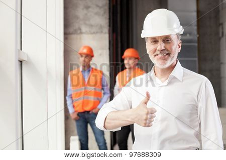 Successful senior engineer is showing his positive emotions
