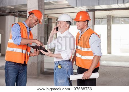 Skilled construction team is waiting for approval of work