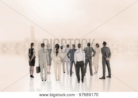 Business team against white room with large window overlooking city