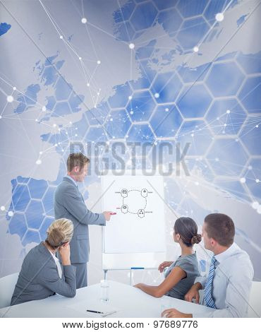 Manager presenting whiteboard to his colleagues against background with europa map