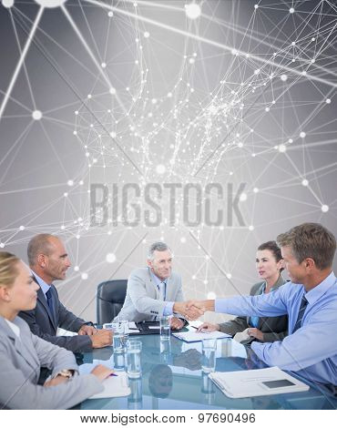 Business team during meeting against grey background