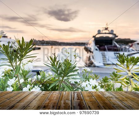 Empty Wooden Deck Table With Boats And Dusk Sky On Background