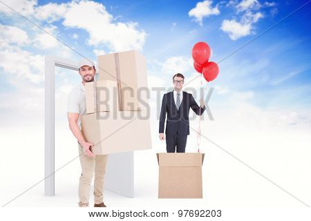 Delivery man carrying cardboard boxes against open door in sky
