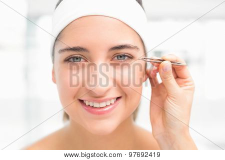 Close up of a hand applying eyeshadow to beautiful woman