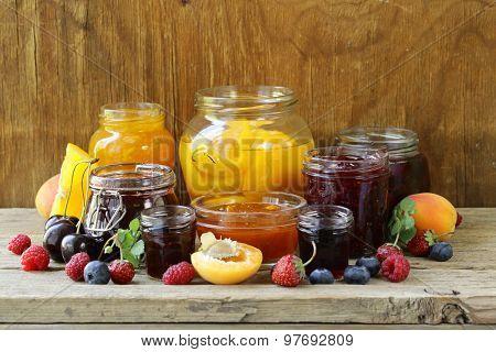 Assorted fruit berry jams (apricot, strawberry, raspberry, orange)