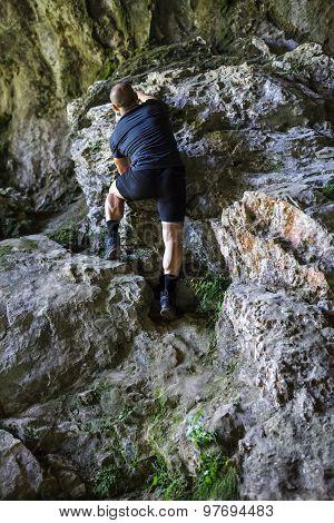 Man Climbing On Rocky Mountain