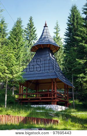 Wooden Shelter Near A Pine Forest