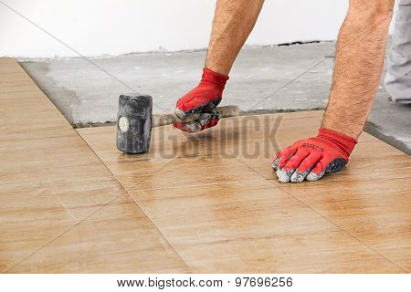 Home Improvement, Renovation - Construction Worker Tiler Is Tiling, Ceramic Tile Floor Adhesive