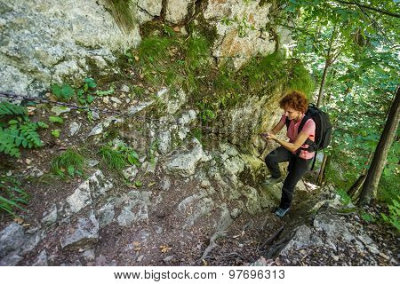 Backpacker Lady On A Safety Chain In The Mountains