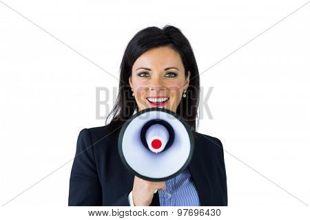 Businesswoman shouting through a megaphone on white background