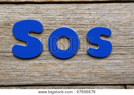 Sos Word Made Of Colorful Magnets
