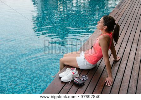 Sporty Woman Relaxing At Poolside