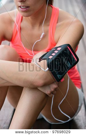 Sporty Woman With Earphones And Cellphone Armband