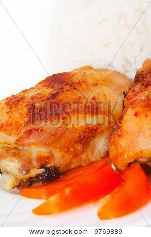 Roasted Chiken Thighs, Rice And Tomato on white plate