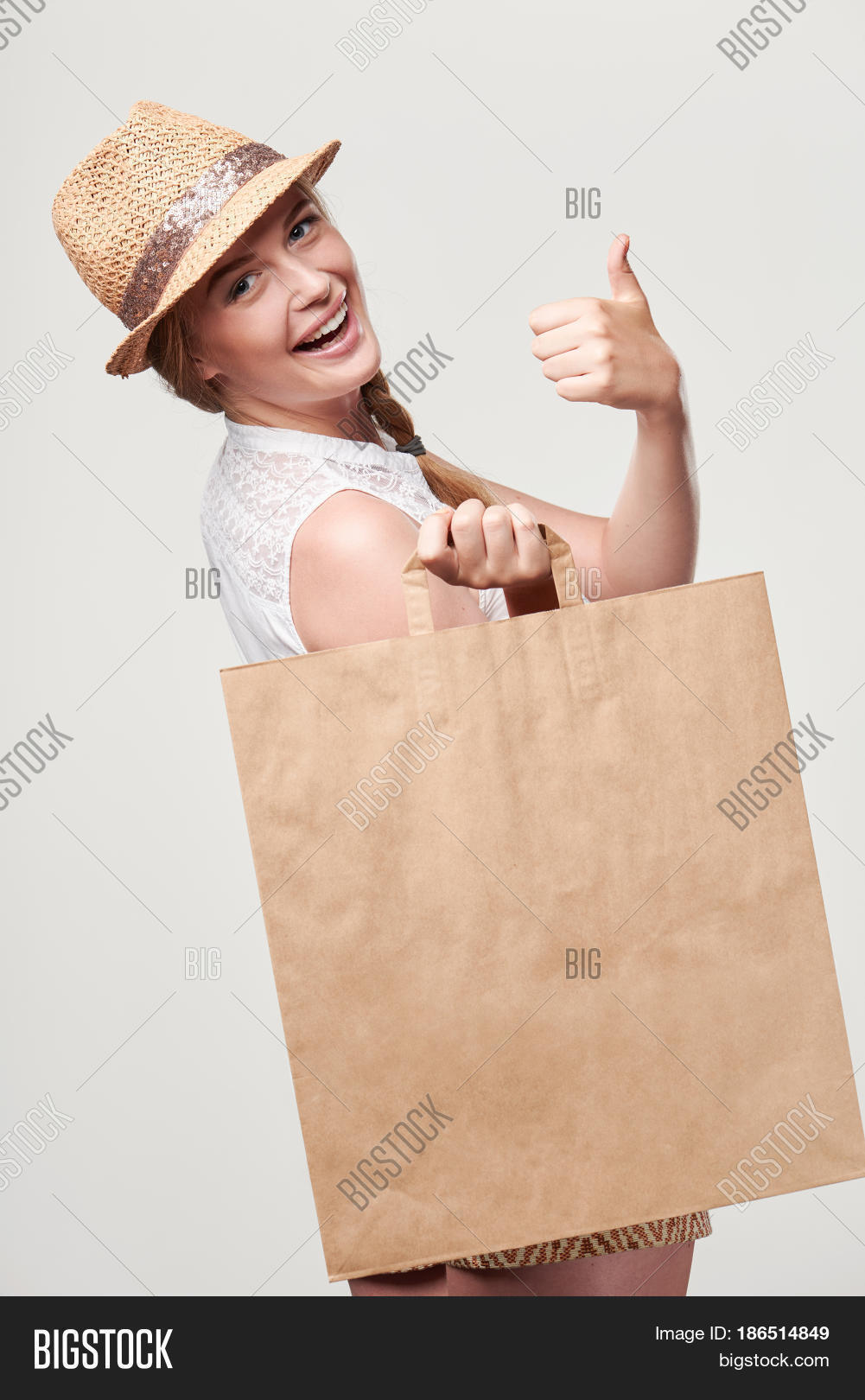 Innovative  Of Woman Wearing A Pink Cheongsam Holding A Shopping Bag  Stock Photo