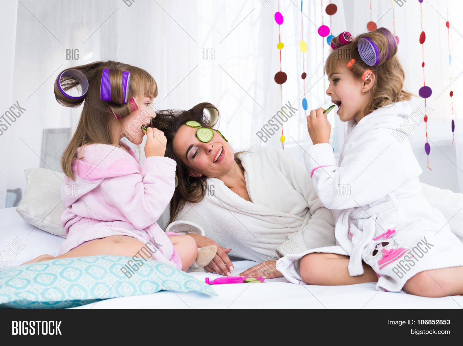happy loving family mother and children are doing hair