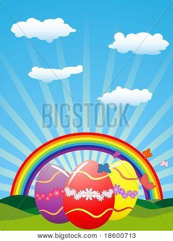 Easter eggs under rainbow and sun-rays