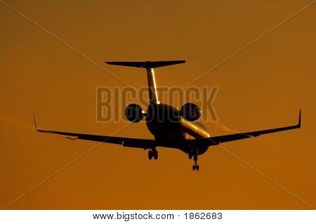 Silhouette Of Regional Jet Facing Sun