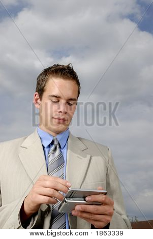 Young Businessman With Pda