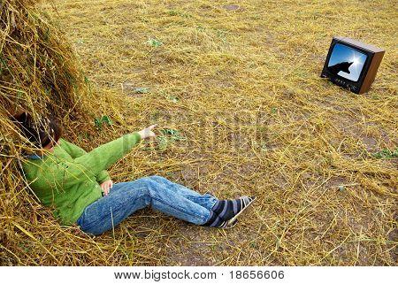Girl on hay watch tv. Conceptual design.