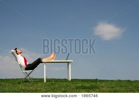 Businessman Sitting At Desk, Outdoors
