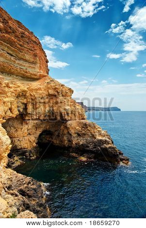 Cave in rock at the sea. Nature composition.