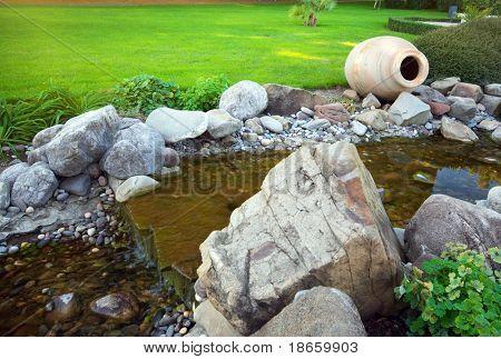 Big pitcher in park. Nature design.
