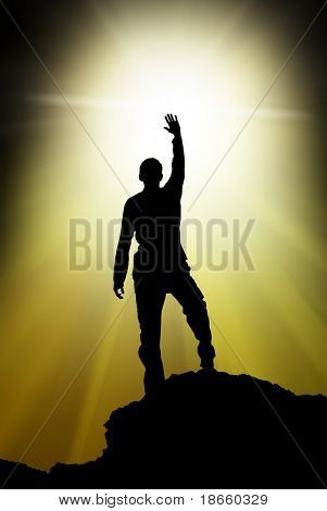 Silhouette of man touch the sun.