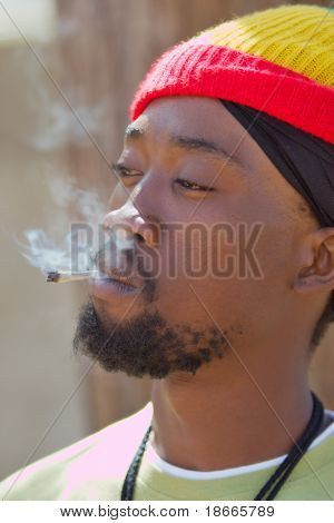 Rastafarian man smoking cannabis