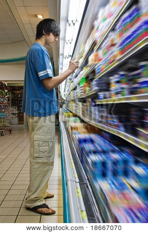 Young Caucasian man shopping in a supermarket
