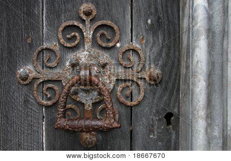 The door handle on an medieval door of a massive old chirch