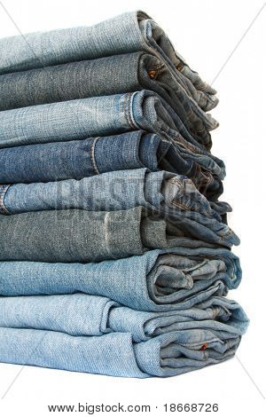 jeans pile over white, soft focus