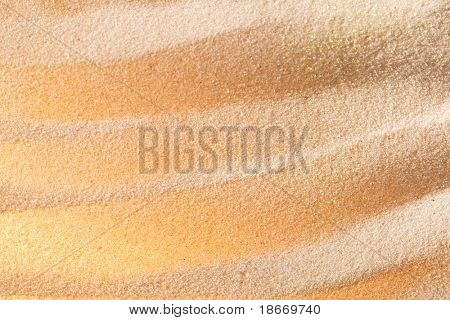 bright glitter sand, shallow DOF, different kind of color lights