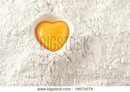 love to bake it!  egg  yolk on flour, full frame
