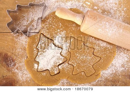 christmas gingerbread tree cookies with cutter , dough and rolling pin, full frame