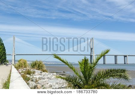 View at the Vasco da Gama bridge from the walkway along the Tajo river April 27, 2017 in Lisbon Portugal