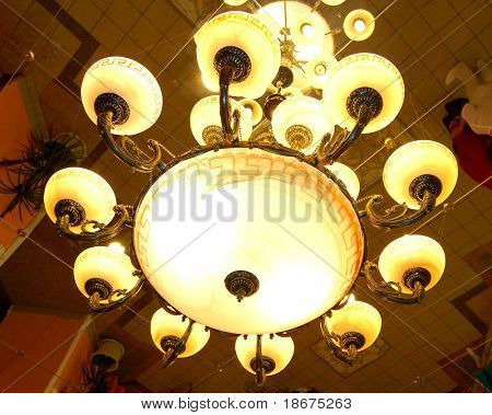 Close-up of Modern Classics Chandelier. Mirror Ceiling.