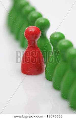 Board game pieces - symbol for leadership or mobbing