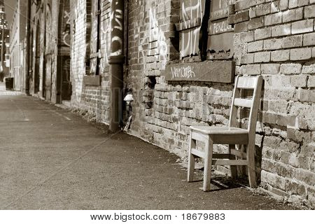 An empty chair in Brooklyn and a wall of graffiti, New York City