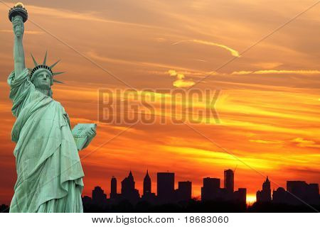 New York City Skyline and The Statue of Liberty at Sunset