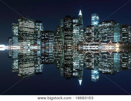 New York City Skyline and Manhattan Bridge At Night