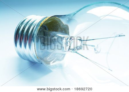 A macro shot of a light bulb , retro style toned photo with shallow DOF