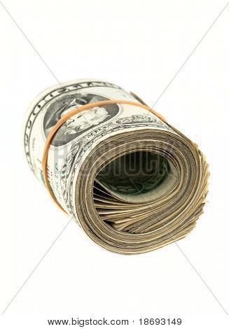 Money background - US dollars rolled on white background. Close up photo with shallow DOF