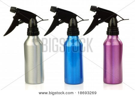 three colorful metal spray bottles